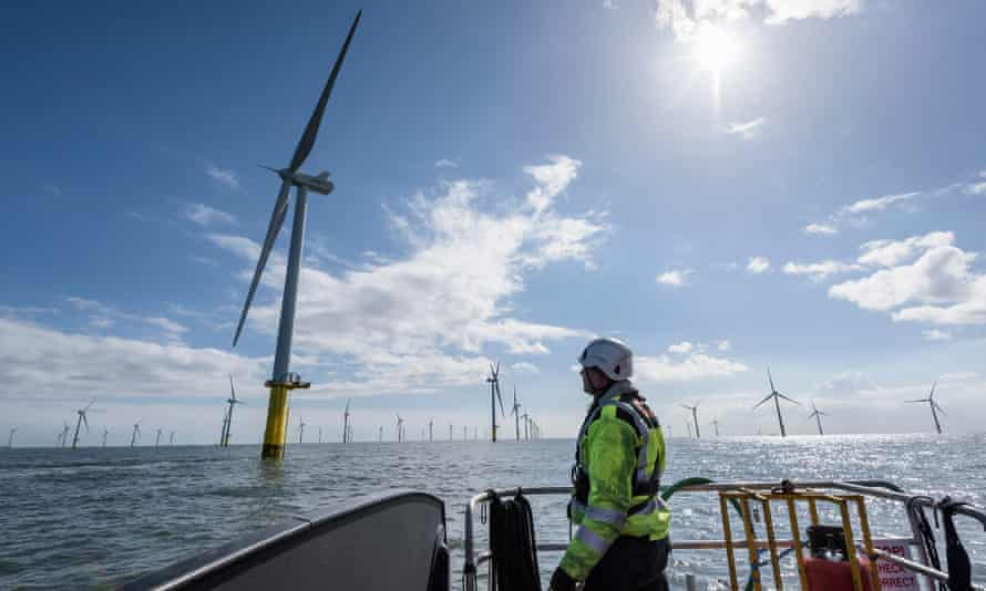 An engineer at a windfarm off the coast of the UK.