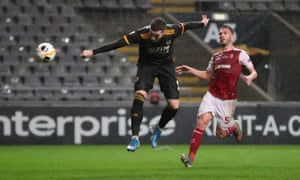 Wolverhampton Wanderers' Matt Doherty heads home their second goal.