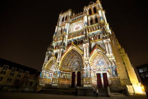 Amiens cathedral lit up at night.