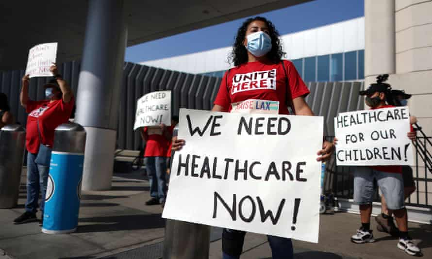 People protest for extended healthcare for laid-off airport workers amid the coronavirus pandemic.