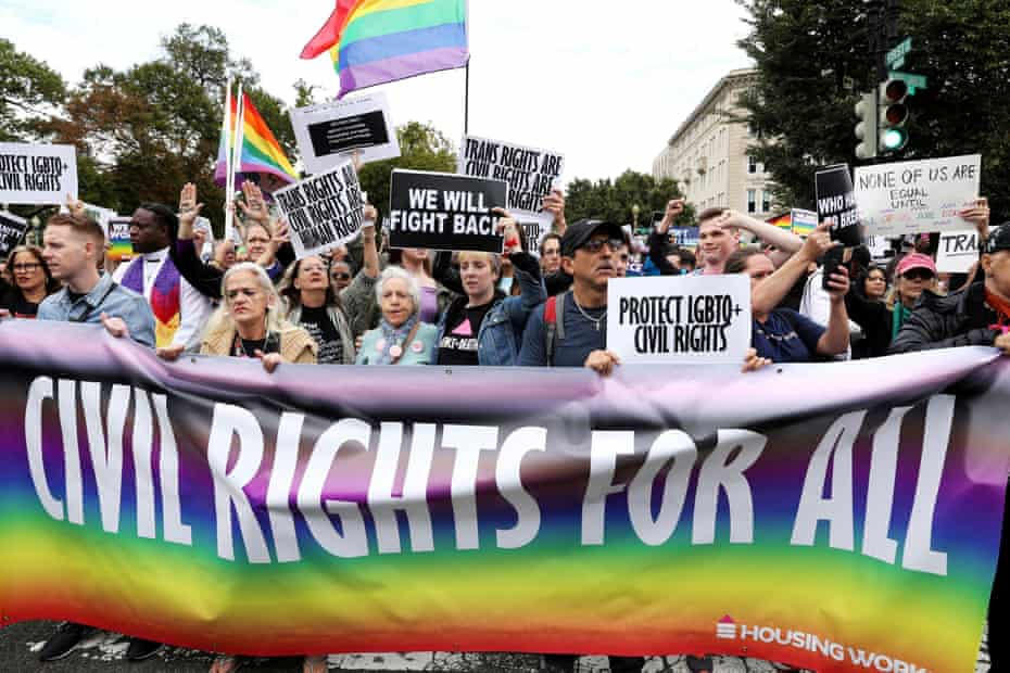 LGBTQ+ activists and supporters protest outside the US supreme court as it hears a rights case on a federal workplace anti-discrimination law.