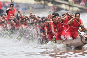 Participants compete in a dragon boat race held to celebrate the Duanwu Festival in Guangzhou, China