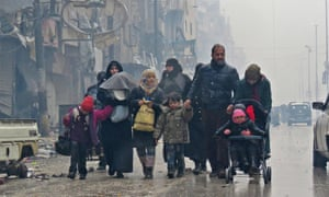 Syrian residents, fleeing the restive Bustan al-Qasr neighbourhood, arrive in Aleppo's Fardos neighbourhood