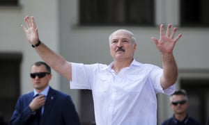 Lukashenko in a short-sleeved shirt gesturing with both hands