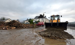 Flood debris is moved off the road in Keswick after December's floods.