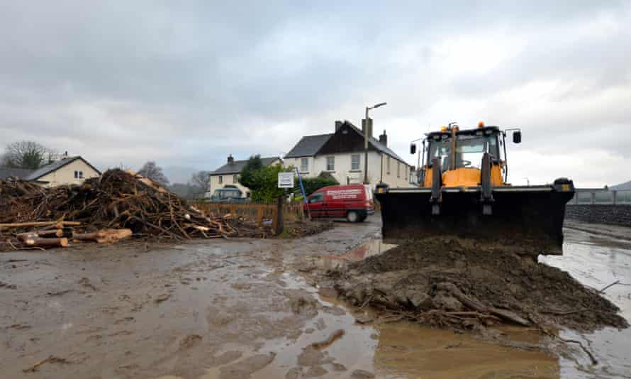 Flood debris is moved off the road in Keswick.