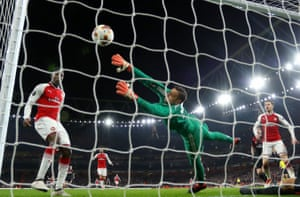 Danny Welbeck nods past the despairing Gianluigi Donnarumma to seal Arsenal's victory.