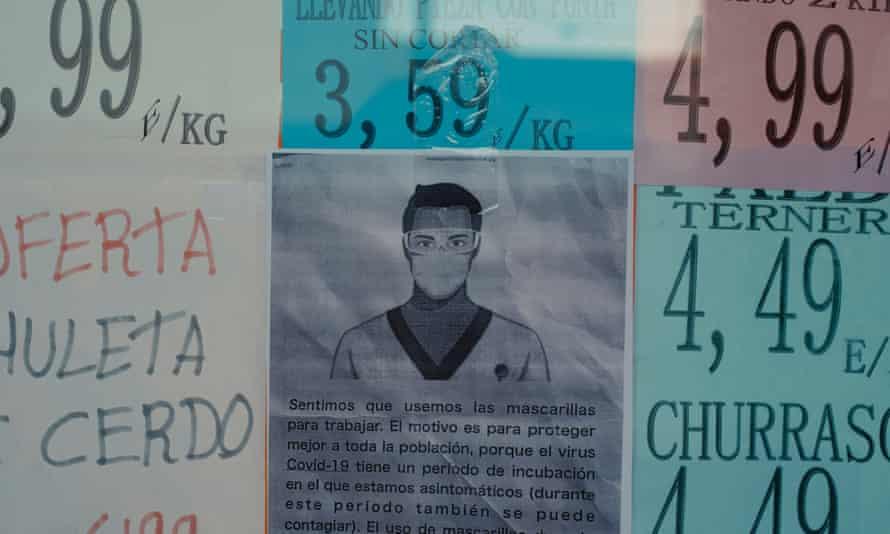A butcher shop displays COVID-19 information, Parla, Spain