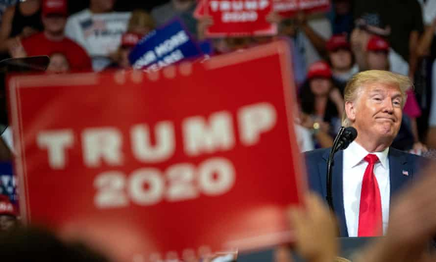 Trump at an election rally in 2019. An expert told the New York Times such 'dark pattern' digital marketing 'should be in textbooks of what you shouldn't do' in politics.
