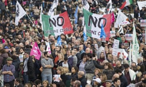 People hold flags reading 'No to civil unions' at Circus Maximus in Rome.