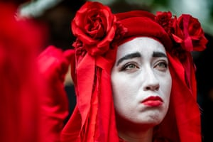 """Members of the Red Brigade were also present. The XR-adjacent group say their costume """"symbolizes the common blood we share with all species, that unifies us and makes us one.""""The group originated in Bristol as a part of a circus there."""