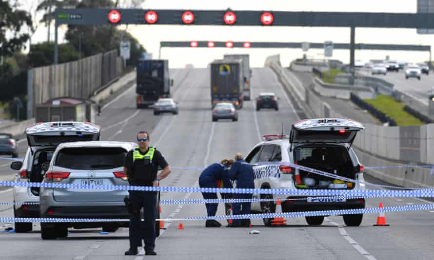 Forensic investigators attend the scene of a police shooting along the Monash Freeway in Melbourne.