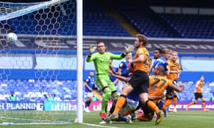Hull's Josh Magennis heads in the early goal at St Andrews.