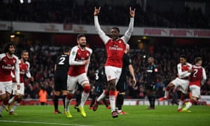 Danny Welbeck celebrates after opening the scoring for Arsenal moments before half-time.