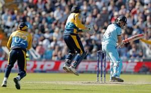 Chris Woakes is caught by Sri Lanka's Kusal Perera.