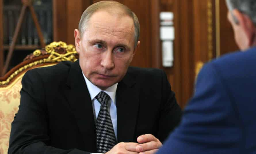 Russian President Vladimir Putin, left, listens during a meeting in Moscow's Kremlin, Russia, on Wednesday, Aug. 3, 2016. (Mikhail Klimentyev/Sputnik, Kremlin Pool Photo via AP)