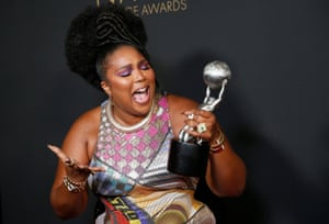 Lizzo poses backstage with her Entertainer of the Year award at the 51st NAACP Image Awards, Pasadena
