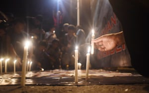 <strong>Manila, Philippines</strong> Relatives of the victims of the slain journalists conduct a torch parade and prayer vigil in commemoration of the 6th anniversary of the Maguindanao Massacre.