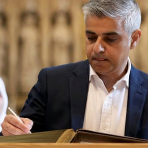 Sadiq Khan attends the signing ceremony