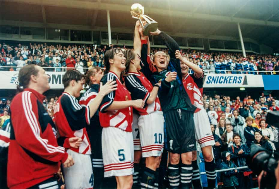 Norway's goalkeeper Bente Nordby lifts the trophy after defeating Germany in the final of the FIFA women's football World Cup 1995 at Rasunda Stadium in Stockholm, Sweden.