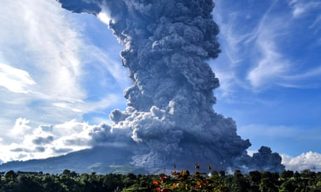 Indonesia's Mount Sinabung spews huge column of ash during latest eruption – video