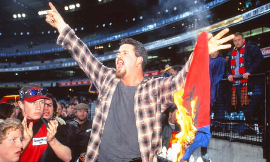 A Fitzroy fan burns a flag