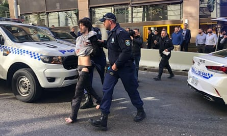 Mert Ney is arrested on York Street by police after people on the street wrestled him to the ground
