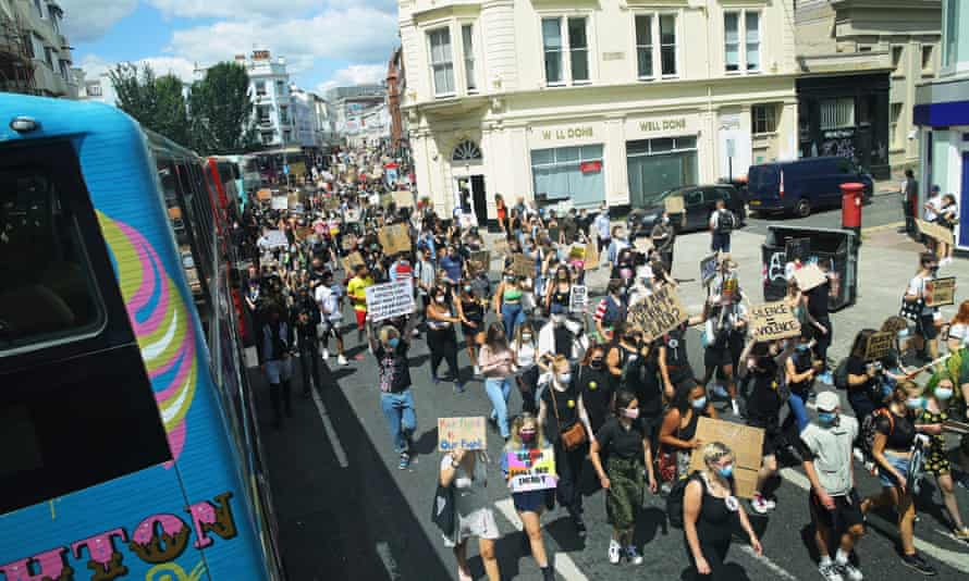 Protesters march through the streets of Brighton on 11 July.