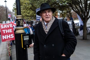 Vince Cable walks past as Brexit protesters demonstrate outside the Houses of Parliament on January 15, 2019.