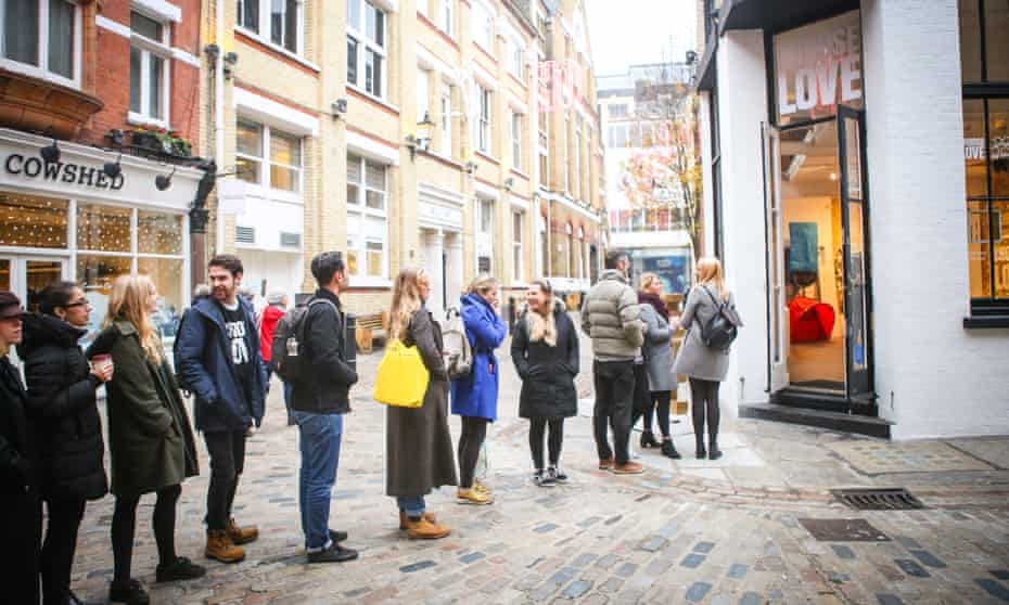 People queueing outside store off Carnaby Street