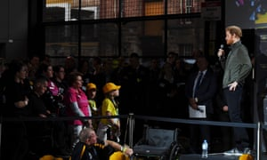 Prince Harry addresses the crowd after watching demonstration sports during the launch of the Invictus Games in Sydney