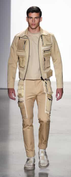 Calvin Klein does Californian Khaki with slider-like slippers and socks.