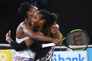 Serena Williams hugs Venus Williams after winning the women's singles final.