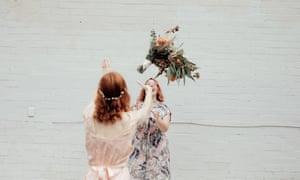 A socially distanced bouquet toss