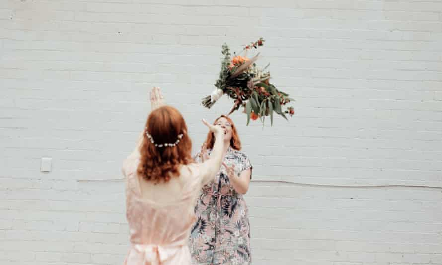 A socially distanced bouquet toss