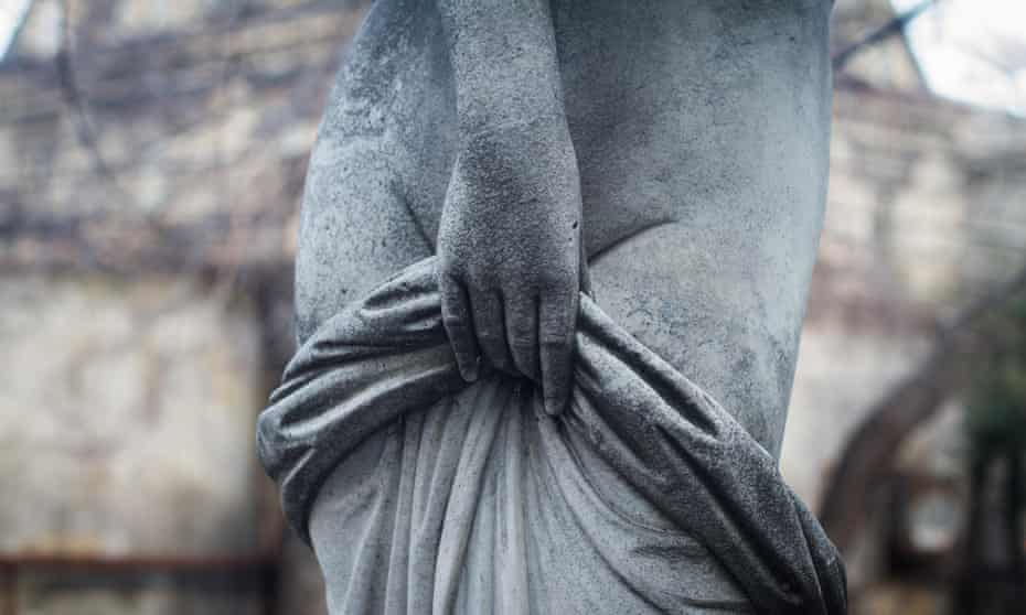 front view detail closeup of old woman stone sculpture statue with hand covering naked body with cloth<br>M3MR38 front view detail closeup of old woman stone sculpture statue with hand covering naked body with cloth vagina
