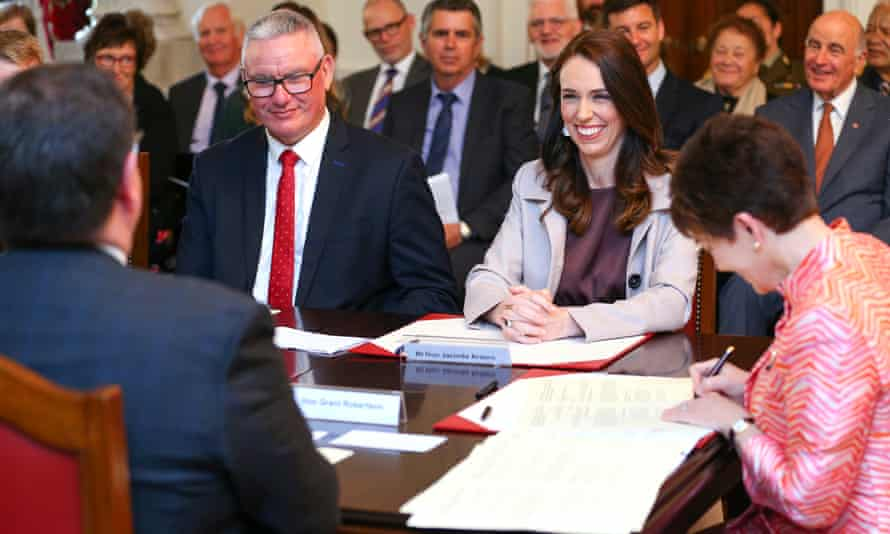 Prime Minister Jacinda Ardern enjoys a laugh with Deputy Prime Minister Grant Robertson (far left) during a swearing-in ceremony in Wellington