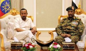 Ethiopian prime minister Abiy Ahmed, left, meets Sudan's Lieutenant General Abdel Fattah Al-Burhan Abdelrahman to mediate in the political crisis in Khartoum