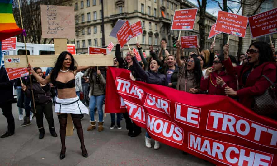 Transgender sex workers protest in Parios against a parliamentary vote on legislation making it illegal to pay for sex