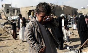 A boy cries near houses hit in airstrikes by the Saudi-led coalition in the Yemeni capital, Sana'a, on Sunday. Six people were killed and seven injured.
