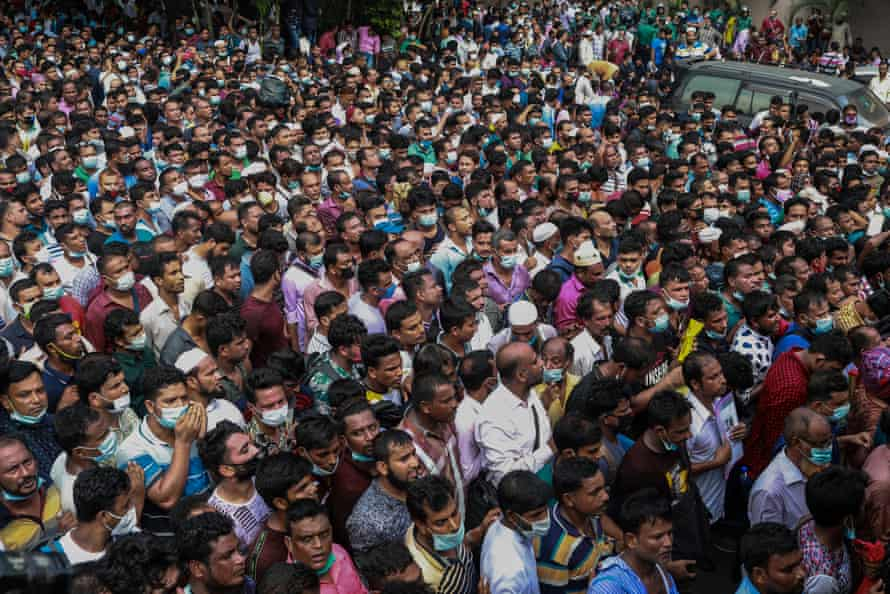 Migrant workers at the Saudi Arabian airline offices in Dhaka, Bangladesh, 4 October.