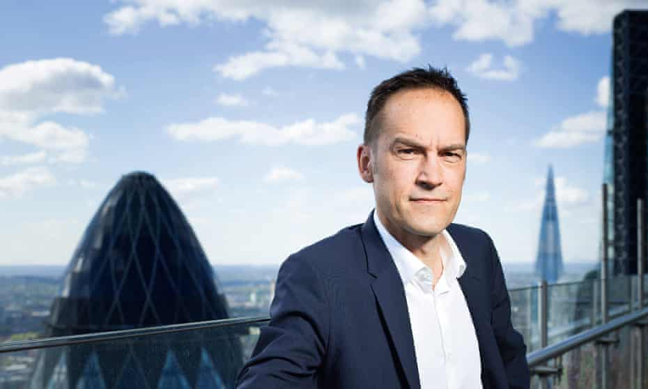 Alexis Stenfors on a London roof with the Gherkin and Shard behind him