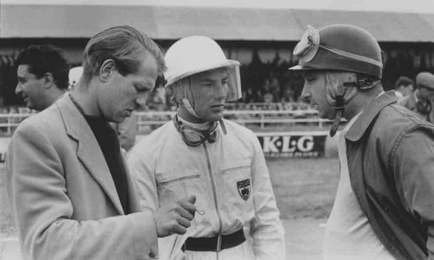Peter Collins, left, Stirling Moss, centre, and Argentina's Juan Manuel Fangio at the British Grand Prix at Silverstone in July 1956.