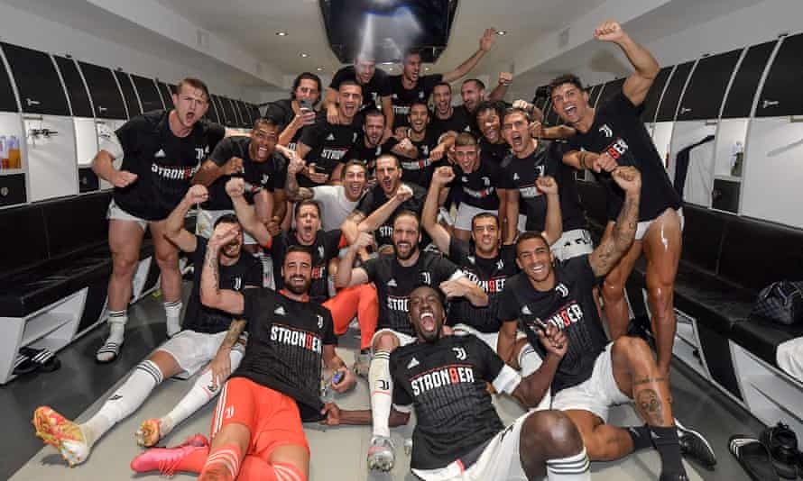 Juventus players celebrate in the dressing room after sealing their ninth consecutive scudetto.