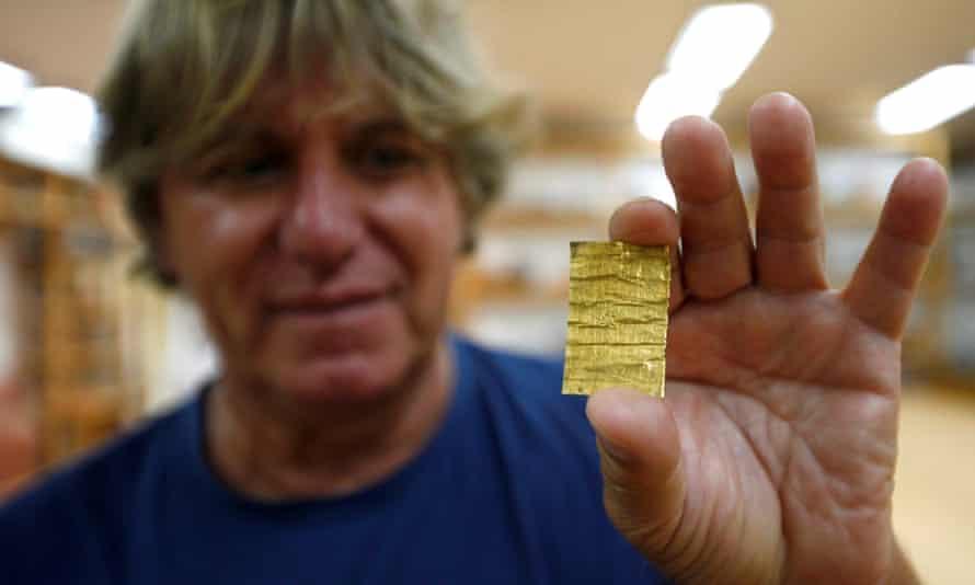 Chief archaeologist Miomir Korać displays one of the gold rolls