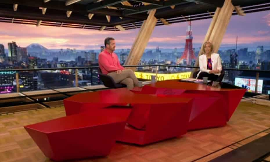 Presenters in studio with views of Tokyo behind them