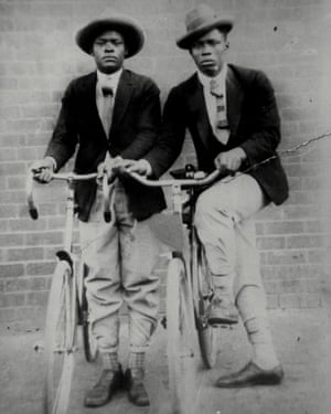 Two black South African men pose proudly with their bicycles in 1922.