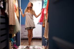 Carrie Bradshaw in her walk-in wardrobe in Sex and the City 2.