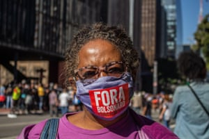 A protester in Sao Paulo on Sunday, whose masks reads 'Bolsonaro out'.