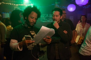 Boots Riley and Steven Yeun on the set of Sorry to Bother You.